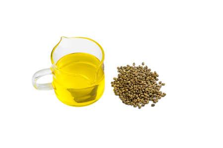 CBD hemp oil, Bottle with hemp oil and unshelled hemp seed on white background , medical marijuana concept. Фото со стока