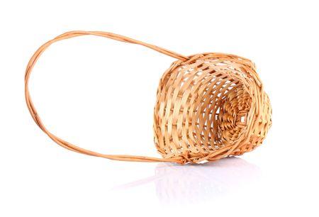overturned: Traditional wicker overturned basket isolated on white background  Stock Photo
