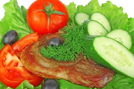 piece grilled meat beef steak on plate with green salad tomato cucumber and olive isolated white background photo