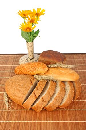 foodstuffs: Composition of fresh bread and bakery with ear of wheat, burlap and flowers foodstuffs Stock Photo