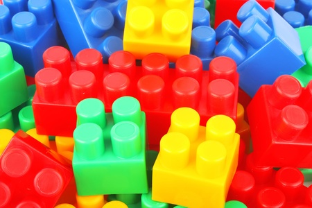 Plastic building blocks background, colorful childrens toys photo