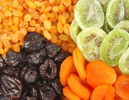 Mixed dried fruits background, health food concept. photo