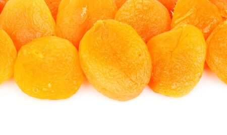 Dried apricot fruits on white background, health food concept