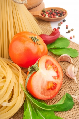 Italian pasta with spices and vegetables, food ingredients photo