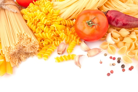 Different types of Italian pasta and spices, food ingredients photo
