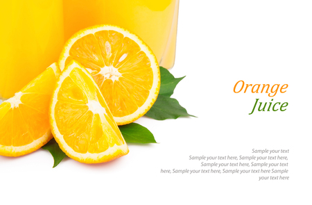 Orange juice in glass jar and oranges fruit with green leaves photo