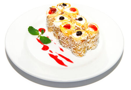 ingestion: Cake roll with curd cream, berry and syrup, sweet dessert on plate