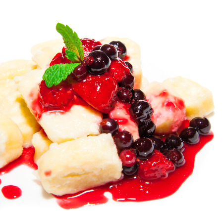 ingestion: Pudding curd with fruit and syrup dessert on plate