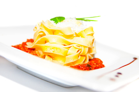ingestion: Pasta with meat tomato sauce bolognese, cheese on plate, restaurant menu Stock Photo