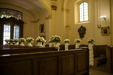 church flower: Beautiful flower decoration for wedding ceremony in church Editorial