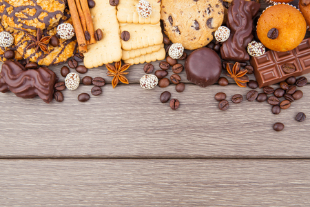 chocolate chips cookies: Cookies and candies with coffee beans and spices on wooden