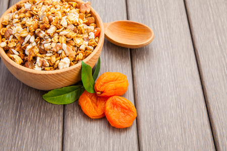 frutas secas: Muesli with nuts and dry fruits on wooden, tasty health breakfast Foto de archivo
