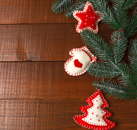 Christmas homecraft toys decoration on branch, holiday symbols from felt and beads on wooden,