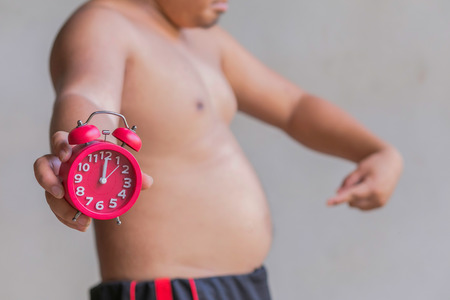 regenerate: Obese men show signs of hunger and time. Stock Photo