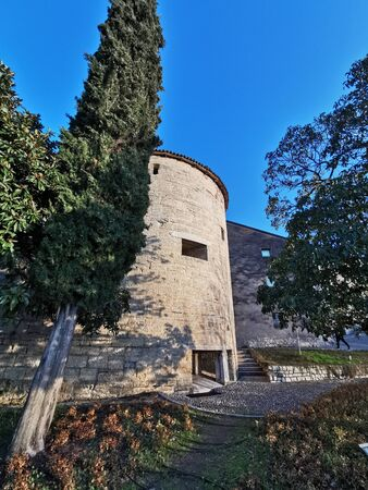 defense tower on the walls of the castle of Brescia at sunset Stockfoto