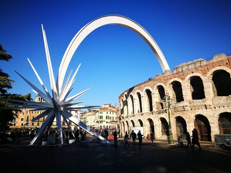 Verona panorama with arena and white Christmas star during the Christmas period