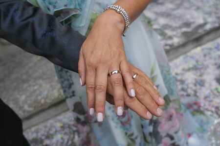groom and bride with wedding rings nails hands