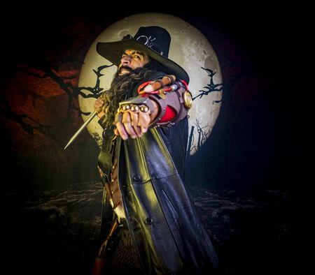 beautiful boy gothic demon vampire hunter with stake Standard-Bild