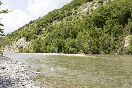 panorama of the river enza in reggio emilia with vegetation and stream