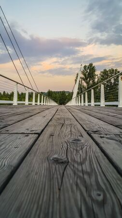 wooden bridge over Secchia river at sunset Sassuolo Modena. High wooden bridge over Secchia river at sunset Sassuolo Modenaquality photo Banque d'images