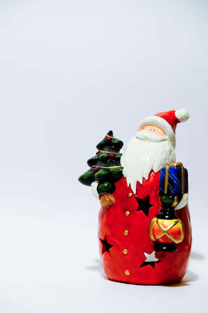 christmas statue of santa claus isolated on white background. High quality photo