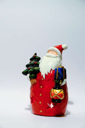 christmas statue of santa claus isolated on white background. High quality photo Stock Photo