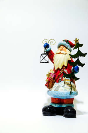 christmas statue of santa claus isolated on white background with lantern in hand. High quality photo