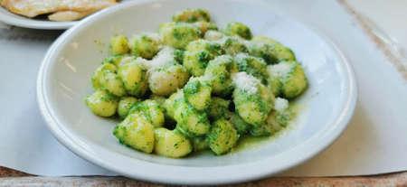 potato gnocchi with pesto alla genovese herb sauce. High quality photo