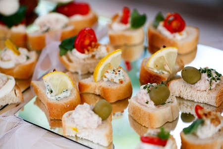 buffet for wedding ceremony with savory snacks and sandwiches. High quality photo