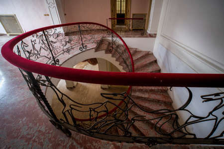 staircase with iron railing and handrail in abandoned luxury house. High quality photo Standard-Bild