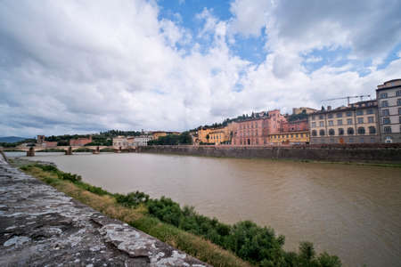 Landscape of a bridge and Arno RIver in Florence, Italy. High quality photo Banco de Imagens