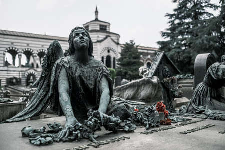 statue of angel on stone grave High quality photo