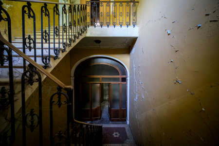 grand staircase with metal balustrade in old abandoned house. High quality photo