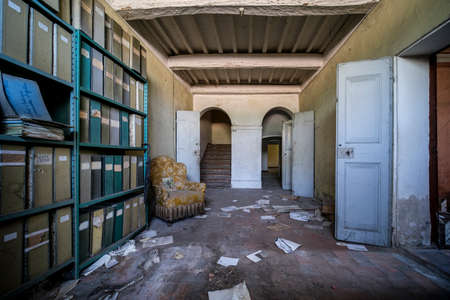 filing cabinets and documents abandoned in old factory, high quality photo