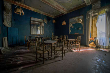 dining room in abandoned restaurant with chairs and tables, high quality photo