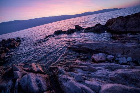 lake garda salo beautiful colorful sunrise with rocks. High quality photo