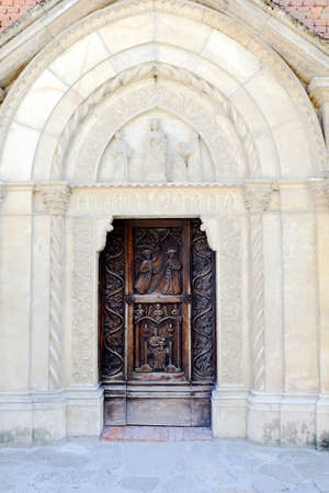 Detail of the entrance of the small gothic church in the medieval village of Grazzano Visconti near Piacenza, Italy. High quality photo 写真素材