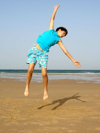 boy jumping of joy on the beach Stock Photo - 434820