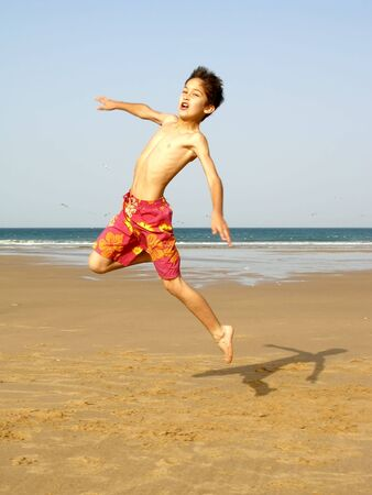 boy jumping on the beach Stock Photo - 434856