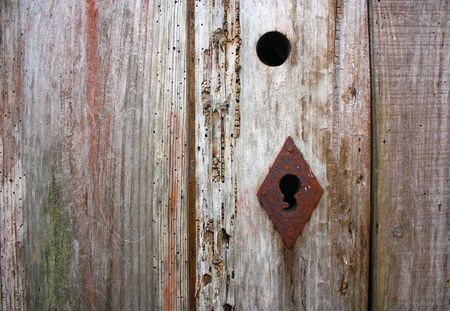 Very old wood door with a rusty keyhole Stock Photo - 6361741