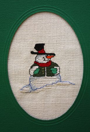 Cross stitch Christmas Card showing a snow man photo