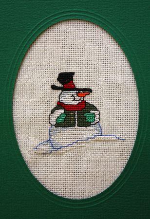punto cruz: Cruz unir la felicitaci�n de Navidad que muestra a un hombre de nieve  Foto de archivo