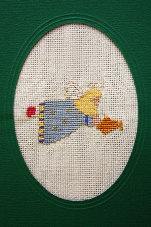 Cross stitch Christmas Card showing a flying angel photo
