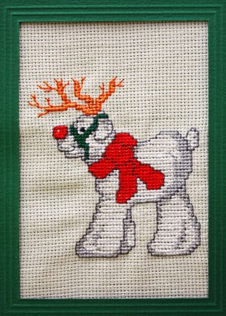 Cross stitch Christmas Card showing a red nose reindeer photo