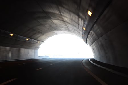 exiting: High speed tunnel. Exiting a tunnel at high speed. Stock Photo