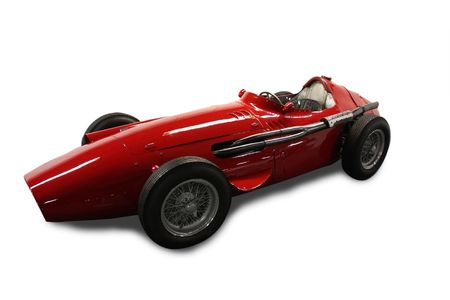 Red vintage sport car isolated in white
