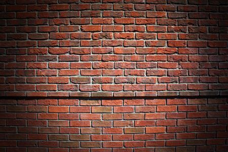 Brick wall with a spotlight in the center Stock Photo