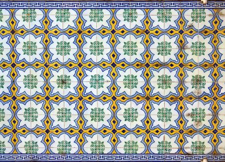 A beautiful abstract tile pattern in blue, yellow, green and white photo