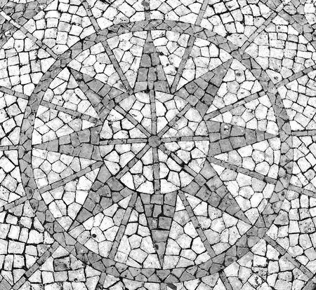 footpath: Mosaic in a Portuguese sidewalk featuring a wind rose Stock Photo