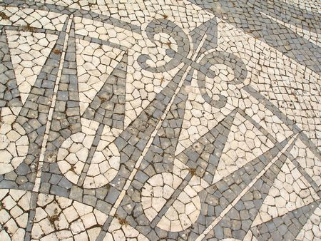 the wind rose: Mosaic in a Portuguese sidewalk featuring a wind rose Stock Photo
